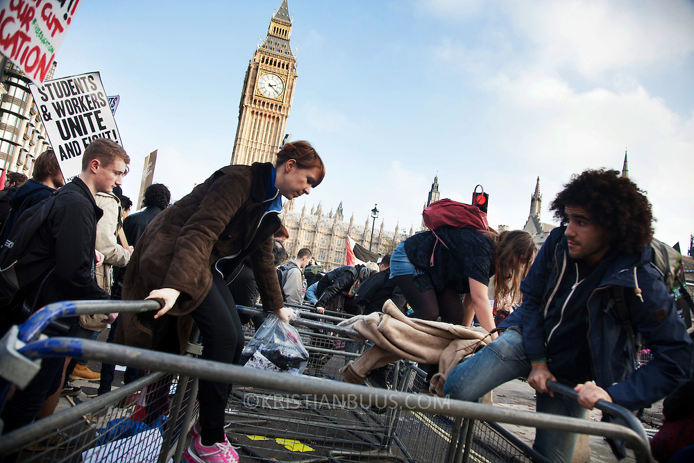 The marching students breached the fence surrounding Parliament Square and the police lines. Thousands of students turned out to a march against fees and cuts in the education sector, calling for workers and students to unite against the Government's austerity policies.