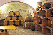 Wine cellar with barrels and bottle bins. Matusko Winery. Potmje village, Dingac wine region, Peljesac peninsula. Matusko Winery. Dingac village and region. Peljesac peninsula. Dalmatian Coast, Croatia, Europe.