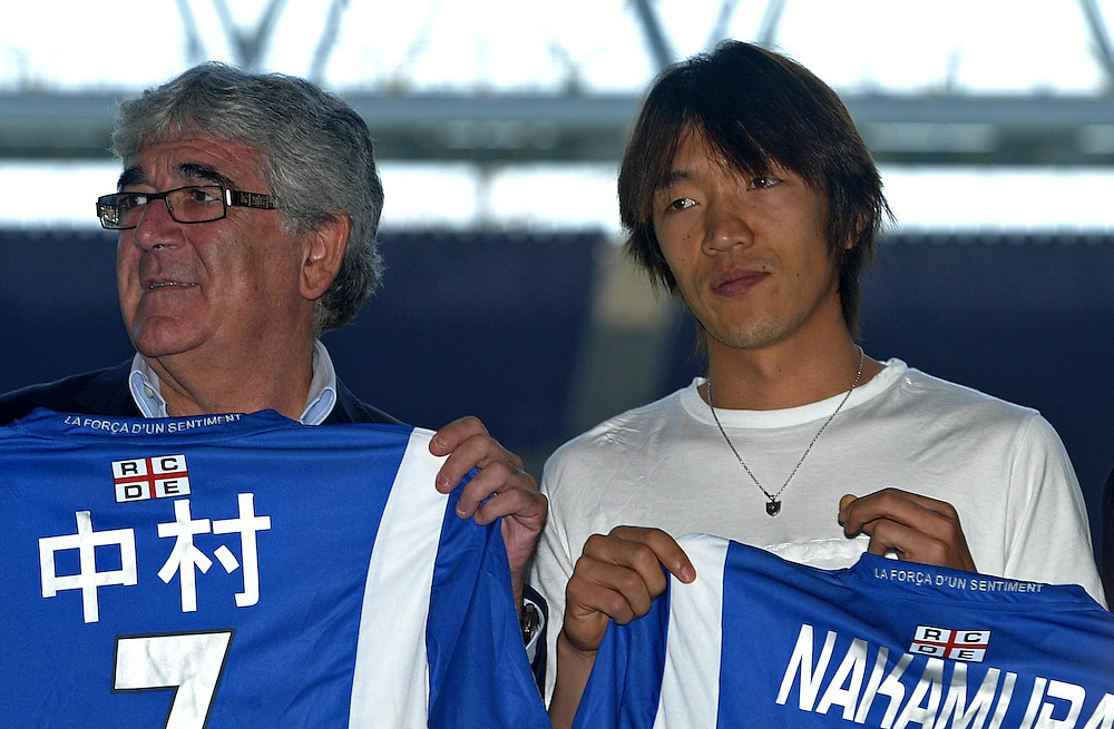 """July 13th. 2009. Official presentation of Shunsuke Nakamura as a  new player of the R.C.D. Espanyol of Barcelona. More than seven thousand supporters and numerous mass media have been present  in the presentation of the new player of the team of first Spanish division league  """"La Liga"""".July 13th. 2009. Official presentation of Shunsuke Nakamura as a  new player of the R.C.D. Espanyol of Barcelona. More than seven thousand supporters and numerous mass media have been present  in the presentation of the new player of the team of first Spanish division league  """"La Liga"""". In the image  the Japanesse player with the president of R.C. D. Espanyol, Mr. Daniel Sanchez Llibre, on his right side."""
