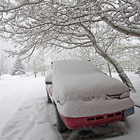 A van lies buried in snow during a storm near Bozeman, Montana.