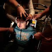 Rosendo Robles, 2, is held down for a chest x-ray to see how badly his lungs are congested at The University of Texas Health Science Center at Houston. Rosendo, who is now 3, has had marked improvement since he has been diagnosed with folate deficiency in August. <br /> Nathan Lambrecht/The Monitor