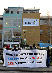 © Licensed to London News Pictures. 30/01/2012, Staines, UK. Protesters outside the building. 6 activists have barricaded themselves into meeting rooms on two floors of British Gas offices in Staines, Middlesex, as part of the 'Winter Warm-Up' weekend called by the campaign group Fuel Poverty Action. British Gas is being targeted as one of the Big Six energy companies making profits out of rising energy bills.   Photo credit : Stephen Simpson/LNP