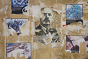 Political posters peeling on a wall in the northern Italian city of Trento. Various pieces of paper have been stuck to the board in the city centre and all have been torn. Trento is an educational, scientific, financial and political centre in Trentino-Alto Adige/Südtirol, in Tyrol and Northern Italy in general. The University of Trento ranks highly out of Italy's top 30 colleges.