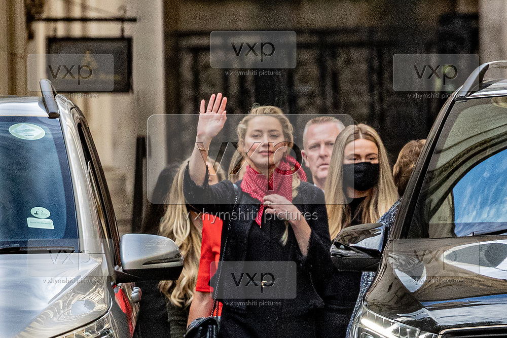 """Actress Amber Heard, centre, leaves the High Court in London, Monday, July 13, 2020. Depp is expected to have wrapped up his evidence at his libel trial against a tabloid newspaper that accused him of abusing ex-wife Amber Heard. The Hollywood star is suing News Group Newspapers, publisher of The Sun, and the paper's executive editor, Dan Wootton, over an April 2018 article that called him a """"wife-beater."""" (VXP Photo/ Vudi Xhymshiti)"""