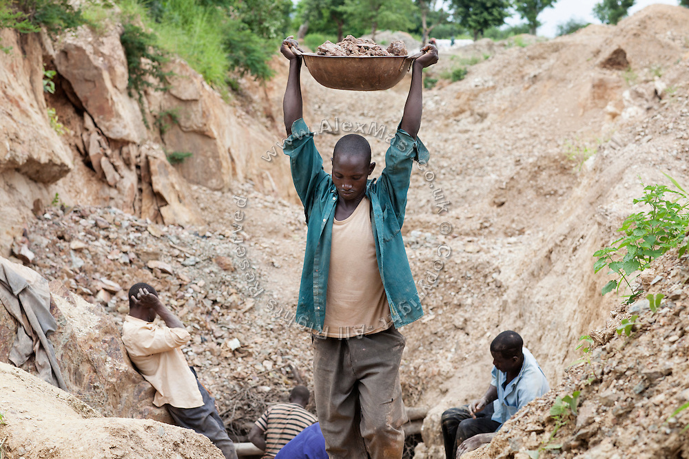 Unlicensed miners are extracting ore containing gold, and other metals like lead, to be sold and processed in artisanal sites near Dareta village, Zamfara State, Nigeria. On October 28, 2011, in this very same mining site, four workers died buried under the ground when a pit suddenly collapsed. The lead contamination is caused by ingestion and breathing of lead particles released in the steps to isolate the gold from other metals. This type of lead is soluble in stomach acid and children under-5 are most affected, as they tend to ingest more through their hands by touching the ground, and are developing symptoms often leading to death or serious disabilities.