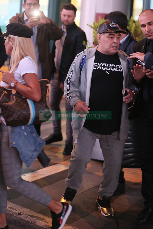 EXCLUSIVE: Legendary footballer Diego Armando Maradona arrives in Rome with girlfriend Rocio Oliva. The couple are in town to meet up Diego's son, Diego Matias, and daughter-in-law, Ninzia Pennino, and their new baby son Diego Junior. 22 Apr 2018 Pictured: DIEGO ARMANDO MARADONA, ROCIO OLIVA. Photo credit: Mertino / MEGA TheMegaAgency.com +1 888 505 6342
