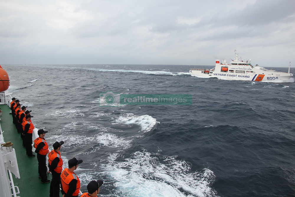 HAIKOU, Nov. 9, 2016 (Xinhua) -- Coast guard ships from China and Vietnam sail in a common fishing zone in the Beibu Gulf, Nov. 7, 2016. China and Vietnam concluded a three-day joint patrol mission in a common fishing zone in the Beibu Gulf Wednesday. Coast guards from both sides completed a series of scheduled tasks, including a joint patrol, maritime search and rescue exercise, and examination of fishing boats, amid strong winds and high waves, according to a China Coast Guard (CCG) statement. (Xinhua/Bai Guolong) (zkr) (Credit Image: © Bai Guolong/Xinhua via ZUMA Wire)