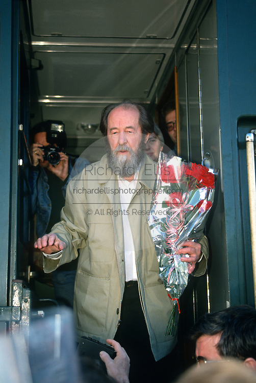 Russian Nobel prize novelist Alexander Solzhenitsyn greets well-wishers  after arriving by train returning to his homeland June 5, 1994 in Khabarovsk, Russia. Solzhenitsyn was expelled from the Soviet Union in 1974 but returned after the fall of the Soviet Union.