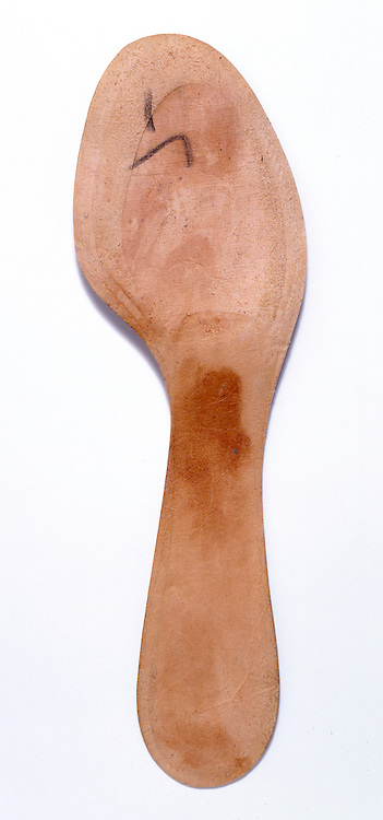 The back of a leather insole of a woman?s shoe.