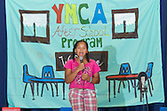"""Middletown, New York -  A girl from the Middletown YMCA's Camp Funshine performs in """"The Show"""", a musical production, on Aug. 7, 2014."""