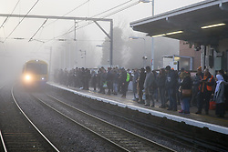 © Licensed to London News Pictures. 06/02/2020. London, UK. Commuters on a platform at a north London overground station as a train travels through dense fog. Photo credit: Dinendra Haria/LNP