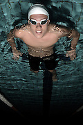 BRISBANE, AUSTRALIA - APRIL 14:  (EDITORS NOTE: Image was rotated from its original perspective.) Australian swimmer Mitch Larkin poses during a portrait session at Sleeman Sports Complex on April 14, 2012 in Brisbane, Australia.  (Photo by Matt Roberts/Getty Images)