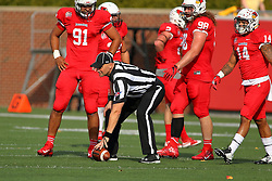 29 October 2016:  Umpire Edward Laco places the ball while watched by Adam Conley, Dalton Keene, and DraShane Glass. NCAA FCS Football game between South Dakota State Jackrabbits and Illinois State Redbirds at Hancock Stadium in Normal IL (Photo by Alan Look)