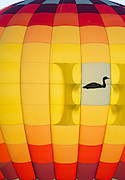 Backlit detail of red and yellow hot air balloon, Crown of Maine Balloon Fair, Presque Isle, Maine.