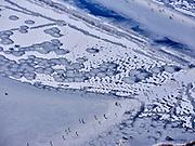 Nederland, Noord-Holland, Gooise Meren, 13-02-2021; de Naardermeer. Het water van het beschermd natuurgebied is door de strenge winter en de stevige vorst bevroren, schaatsers profiteren van het winterse weer.<br /> The Naardermeer. The water of the protected nature reserve has frozen due to the severe winter and the heavy frost, skaters benefit from the winter weather.<br /> <br /> luchtfoto (toeslag op standaard tarieven);<br /> aerial photo (additional fee required)<br /> copyright © 2021 foto/photo Siebe Swart