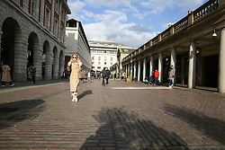 © Licensed to London News Pictures. 13/03/2020. London, UK. A nearly empty Covent Garden as members of the public are staying away from crowded area amid an increased number of Coronavirus (COVID-19) cases in the UK. A tube drive has been tested positive for the virus. 798 cases have been tested positive and ten patients have died from the virus in the UK. Photo credit: Dinendra Haria/LNP