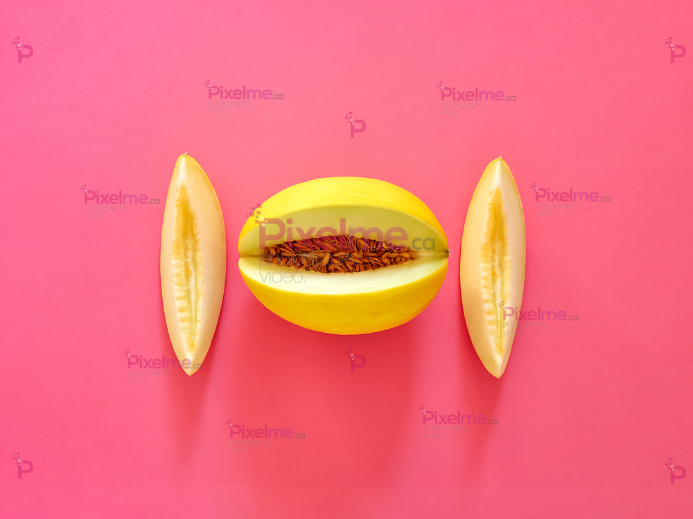 Yellow Melon Fruit isolated in fucsia background viewed from above - flatlay look - Image Minimalism concept