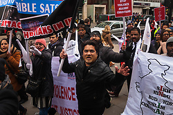 London, February 7th 2015. Hundreds of the UK's Indian Christian community are  joined by Sikhs and Muslims on a protest march from Downing Street to the Indian High Commission, protesting against the persecution of Christians and those of other religions in India where the Hindu Modi government is seen to be discriminatory.