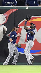 September 13, 2017 - Arlington, TX, USA - The Texas Rangers' Robinson Chirinos flies out to Seattle Mariners center fielder Guillermo Heredia (5) during the fourth inning at Globe Life Park in Arlington, Texas, on Wednesday, Sept. 13, 2017. (Credit Image: © Max Faulkner/TNS via ZUMA Wire)