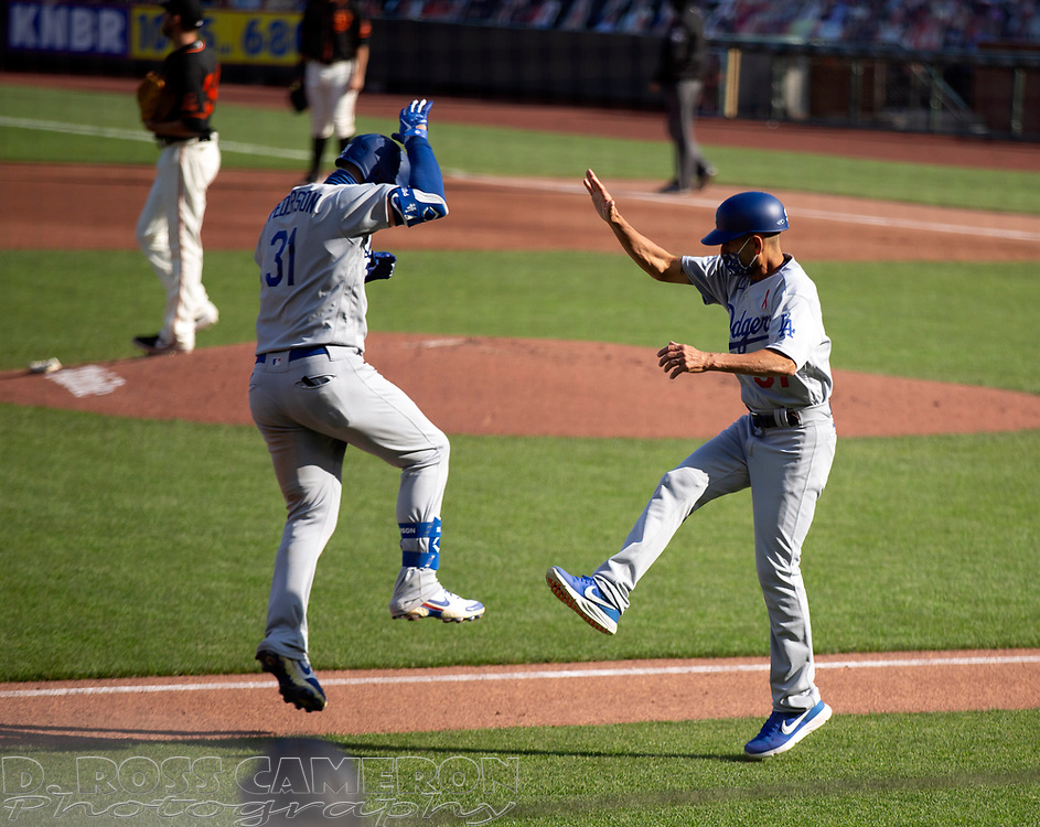 Los Angeles Dodgers' Joc Pederson (31) celebrates his solo home run with third base coach Dino Ebel during the second inning of a baseball game on Thursday, Aug. 27, 2020 in San Francisco, Calif. (D. Ross Cameron/SF Chronicle)