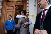 Libyan nationals and diplomatic staff celebrate on the steps outside their London embassy in Knightsbridge, central London on 20/10/11, reacting to the death earlier in Sirte of the dictator Muammar Muhammad Abu Minyar al-Gaddafi, on the day his 42 year rule over Libya came to an official end.