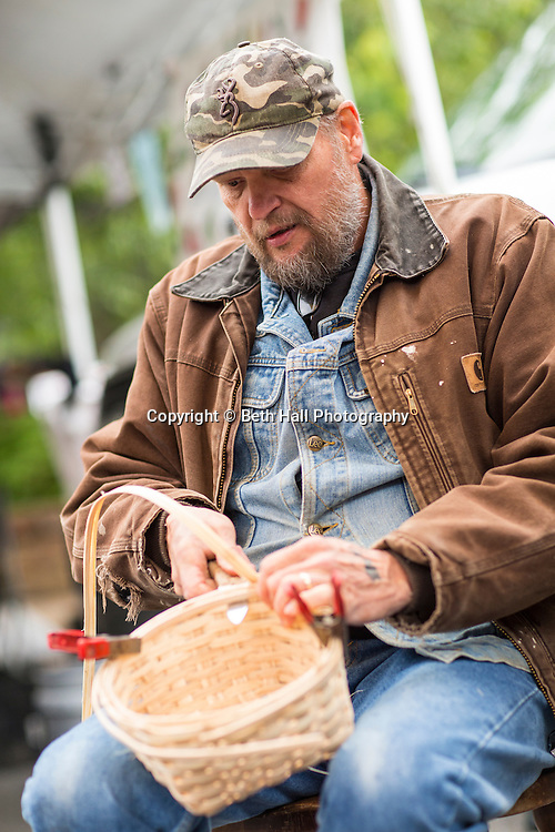 Terry Gibson of Farmington weaves a basket at the Farmer's Market in Fayetteville on Saturday, May 17, 2014, in Fayetteville, Ark. Photo by Beth Hall<br /> <br /> Terry and Bonnie Gibson<br /> 4th generation craftsman<br /> 479-443-3010<br /> terrygibson@gibsonbaskets.com