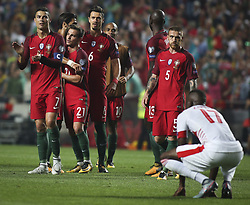 October 10, 2017 - Lisbon, Portugal - Portugal's forward Cristiano Ronaldo (L) celebrating their victory  with temmates during the FIFA 2018 World Cup Qualifier match between Portugal and Switzerland at the Luz Stadium on October 10, 2017 in Lisbon, Portugal. NURPHOTO / CARLOS COSTA  (Credit Image: © Carlos Costa/NurPhoto via ZUMA Press)