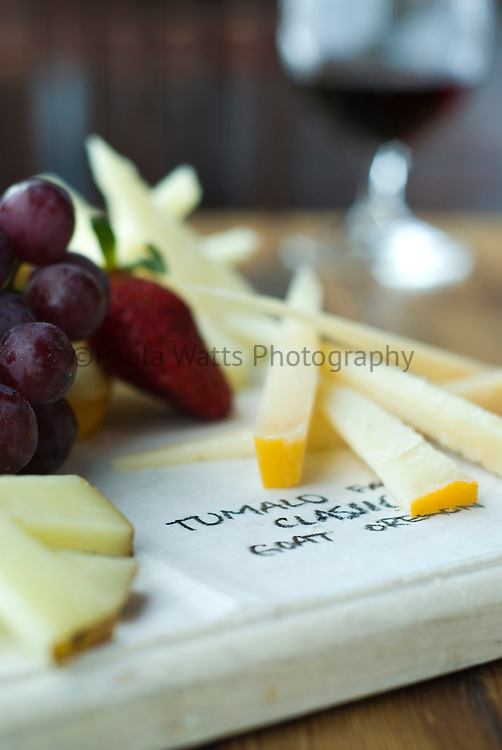 Cheese board with description at restaurant setting
