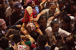 Worshipers try to touch 9-year-old Matina Shakya, the Royal Kumari, as she is brought back to her residence after a procession around the city during the Seto Machindranath Chariot Festival in Kathmandu.