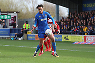 AFC Wimbledon defender Toby Sibbick (20) battles for possession during the EFL Sky Bet League 1 match between AFC Wimbledon and Doncaster Rovers at the Cherry Red Records Stadium, Kingston, England on 9 March 2019.