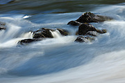 Slow exposure of a series of rocks on the River Farrar, creating a series of diagonals in the water flow.