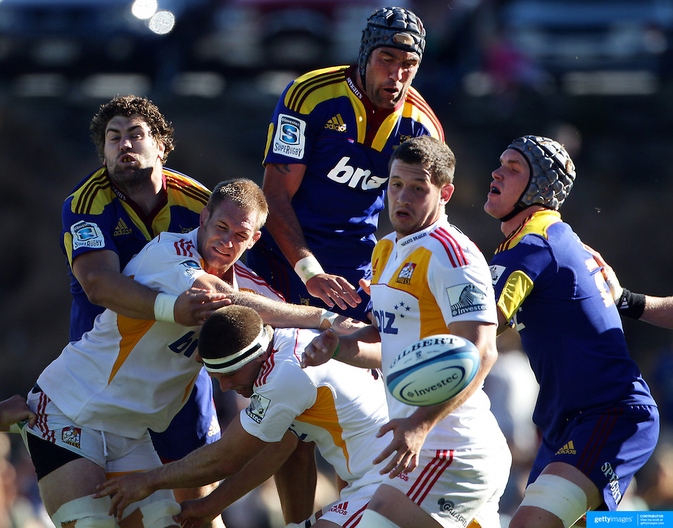 Players challenge form the ball during the Otago Highlanders V Waikato Chiefs, pre season Super 15 rugby match at the Queenstown Recreation Ground, Queenstown, Otago, New Zealand. 11th February 2012. Photo Tim Clayton