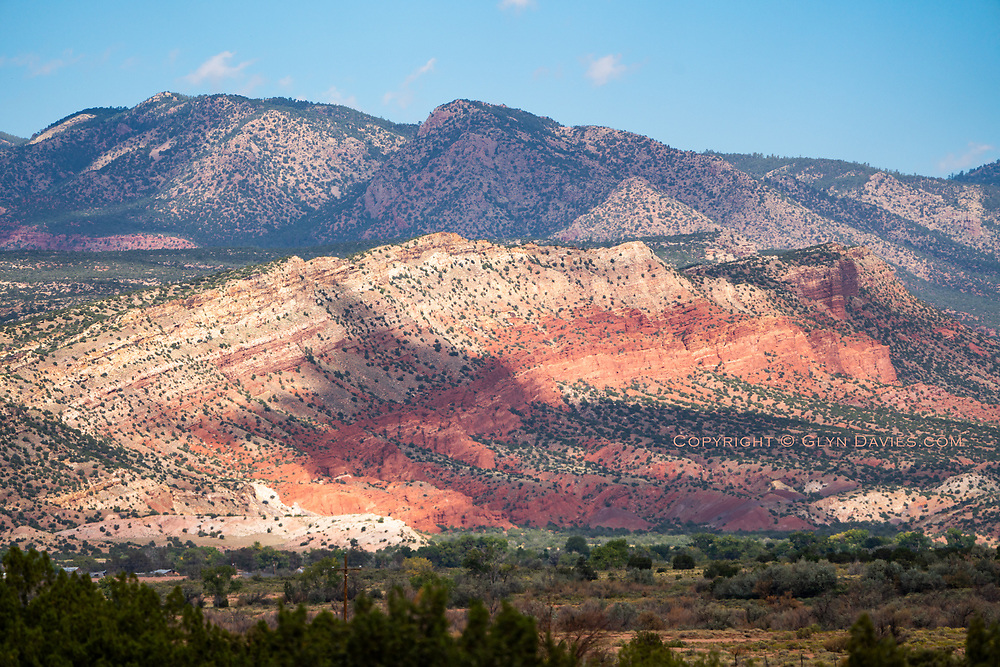 Mind blowing colours threaded through thousands of acres of high mountains as we move North in New Mexico. The heat haze is still apparent in all these distant pictures but in a way does show the high 30º temperatures we're experiencing in this desert landscape.