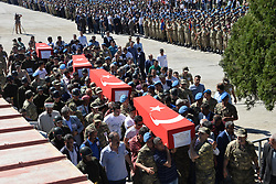 June 1, 2017 - Sirnak, Turkey - Turkish soldiers carry coffins of helicopter crash victims on June 1, 2017, in the southeastern city of Sirnak. Thirteen Turkish soldiers were killed on May 31, 2017 when a military helicopter crashed after hitting a high-voltage power line in the southeast of the country, the army said. The AS532 Cougar helicopter crashed shortly after taking off from a base in Sirnak province bordering Iraq, killing all 13 onboard, it said in a statement. (Credit Image: © Sekvan Kuden/Depo Photos via ZUMA Wire)