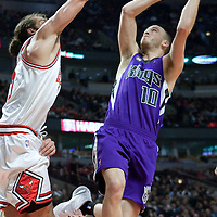 21 December 2009: Sacramento Kings guard Sergio Rodriguez makes a jumpshot against Chicago Bulls center Joakim Noah during the Sacramento Kings 102-98 victory over the Chicago Bulls at the United Center, in Chicago, Illinois, USA.