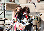 05 November 2012:  Aerosmith's Steven Tyler and Joe Perry perform a free concert in Boston's Allston neighborhood in front of the apartment building, 1325 Commonwealth Ave, which was the band's home in the early 1970's.  Boston, MA. ***Editorial Use Only*****