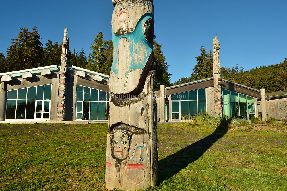 House frontal totem poles in front of the Haida Heritage Centre and museum near Skidegate, Haida Gwaii, British Columbia.