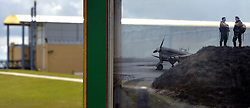 """© Licensed to London News Pictures. 13/03/2013. Duxford, UK A view through a """"Window of the past"""" transparencies displaying archive photographs against the backdrop of the real airfield. . Press preview today 13th March 2013 of """"Historic Duxford"""" designed to explore the RAF's time at the airfield from 1918 to 1961. RAF Duxford is Britain's best preserved Second World War Airfield with a history that dates back to the First World War.  The exhibition opens to the public on the 28th March. Photo credit : Stephen Simpson/LNP"""