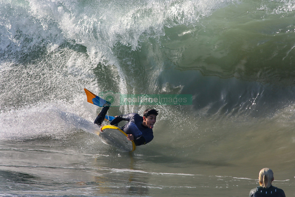 July 6, 2018 - Newport Beach, California, United States - July 6, Newport Beach, California_USA_| At a surf sport known as ''the Wedge'' a body boarder takes advantage of the cool water and big waves hitting Southern California. Inland the temperatures are reaching the 100's. |_Photo Credit: Photo by Charlie Neuman (Credit Image: © Charlie Neuman via ZUMA Wire)
