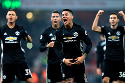 Manchester United's Marcos Rojo celebrates after the final whistle
