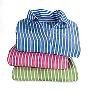 Photograph of three striped shirts shot on a white background to be cut out in post production to create the illusion of a transparent background in the final image.