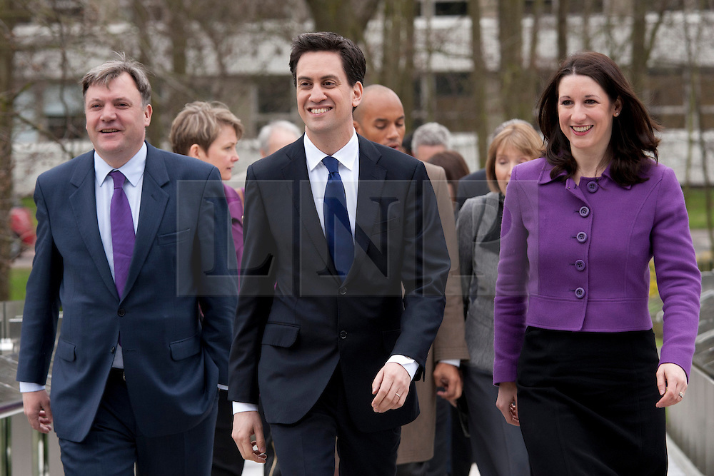 © Licensed to London News Pictures.16/03/2012. Coventry, West Midlands. Labour Party Leader Ed Miliband visited the International Digital Laboratory at the Universty of Warwick, Coventry, earlier today, where he gave a speech at Labour's Youth Conference on Jobs. Ed Miliband, centre, arrives, flanked by Ed Balls, left and Rachel Reeves.Photo credit : Dave Warren/LNP