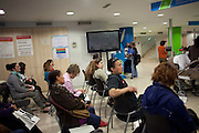 """People waiting to be attended in the unemployment office of Sepulveda street in Barcelona. //Spain's Marchs for Dignity has organized an ocupation of the unemployment offices –INEM- on the eve of May 1st International Worker's Day. With the motto """"bread, work, roof and dignity"""", a total of 400 unemployment offices has been occupied by different movements during two hours (11h to 13h)  in the Spanish State. 6 millions of people are unemployed in Spain, many of them don't get the public assistance from the adminitration and others receive the minimum amount of 426€ at a month. 30th April."""