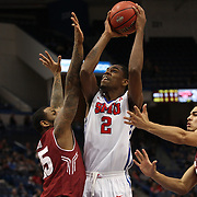 Yanick Moreira, SMU, shoots over Jaylen Bond, Temple, during the Temple Vs SMU Semi Final game at the American Athletic Conference Men's College Basketball Championships 2015 at the XL Center, Hartford, Connecticut, USA. 14th March 2015. Photo Tim Clayton