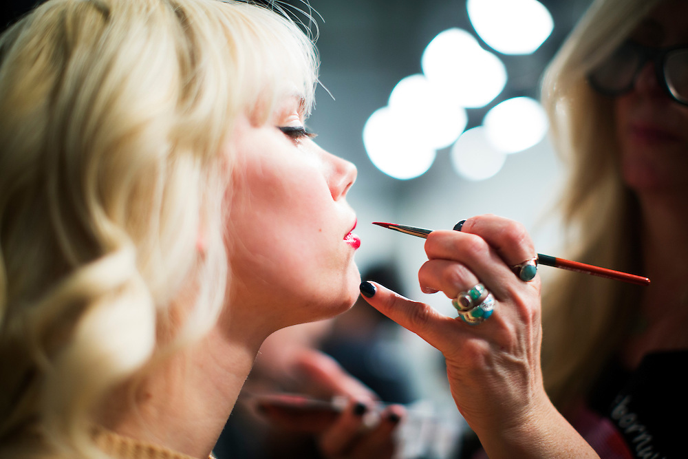 TORONTO, ON - MARCH 14: A model gets her lips painted for the Ellie Mae show during Toronto Fashion Week in Toronto, Ontario. Toronto Star/Todd Korol