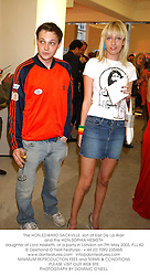The HON.EDWARD SACKVILLE  son of Earl De La Warr and the HON.SOPHIA HESKETH daughter of Lord Hesketh, at a party in London on 7th May 2003.PJJ 82