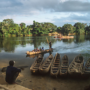 "Transport just about anywhere in Madagascar is very difficult because of the lack of good roads and the seasonal heavy rains, but to travel along the east coast is particularly difficult because there are many rivers to cross, and very few bridges that can actually survive the seasonally bad weather. There are rafts that are either moved manually with poles or powered by motorized boats, or people are ferried in the traditional dugout ""pirogues"". I was amazed at how stable they make them look, even when they are standing up or perched high up on the stern, because when I tried to paddle one, there was only going to be one place that I would end up, and that was in the water."