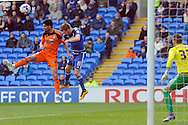 Ipswich's Kevin Bru (l) beats Cardiff City's Craig Noone to a header. Skybet football league championship match, Cardiff city v Ipswich Town at the Cardiff city stadium in Cardiff, South Wales on Saturday 12th March 2016.<br /> pic by Carl Robertson, Andrew Orchard sports photography.