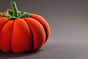 pumpkin made of knitted gray background