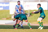 Workington Town prop Stevie Scholey (10) is tackled during the Ladbrokes Challenge Cup round 3 match between Hunslet Club Parkside and Workington Town at South Leeds Stadium, Leeds, United Kingdom on 24 February 2018. Picture by Simon Davies.